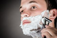 Men shave their face as close as possible without irritating the skin.
