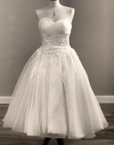 A short fancy white dress with a sweetheart neckline.