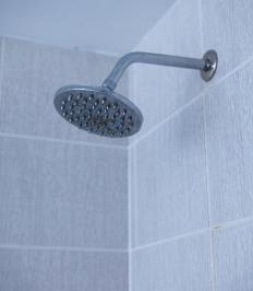 Wiping down granite bathroom surfaces after showering can help minimize hard water stains.