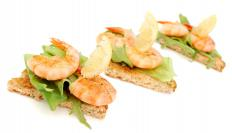 Deveined shrimp on flatbread.