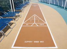 The most traditional form of shuffleboard takes place on large courts, where players push pucks across a scored game board.
