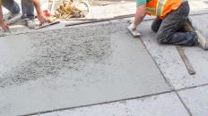 Poured cement is used to make side walks and patios.