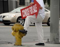 Sign spinners on street corners is one way businesses can cut through the advertising clutter.