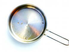 A metal pan on a stove conducts heat.