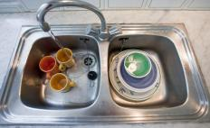 A draining broad provides a surface for washed dishes.