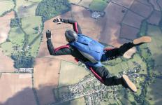 Skydiving is one way someone could face his fear of heights.