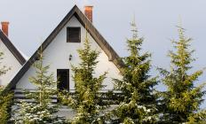 Sloped roofs on an A-frame house prevent snow from building up on top of a house, thus preventing roof collapse.