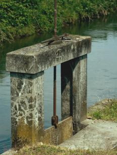 The flow of the water through the penstock can be controlled with a sluice or gate that is raised and lowered.