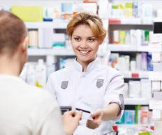 A pharmacy clerk may be responsible for running the cash register.