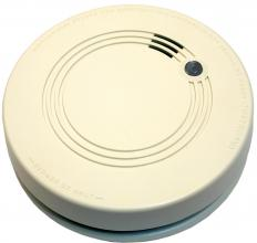 Smoke detectors use either a beam of light or an electrical current to detect the presence of smoke.