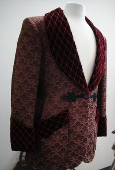 A shawl collar has its origins in the Victorian smoking jacket.