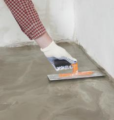 Trowels are used to smooth the surface of the newly-poured countertop.