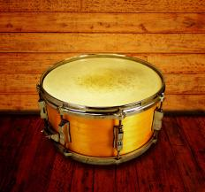 The snare drum is one of four drums commonly found in a drum line.