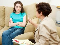 A therapist working with a juvenile offender.