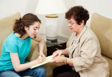 A Licensed Clinical Social Worker (LCSW) working with a teen.