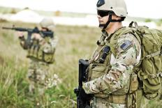 A military power supply may be used in combat situations to charge batteries for a radio or walkie talkie.