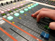 Potentiometers are used in knobs and sliders, such as those on this sound editing equipment.