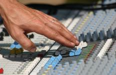 An audio mixer can be used to set the levels of various monitor speakers.