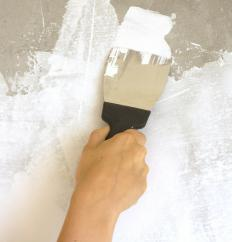 Spackling compound can repair stress cracks in drywall or cement.