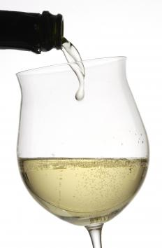 Sparkling wine in an oversized wine glass.