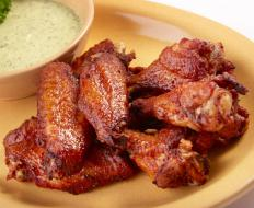 Many people believe the key to moist ovenbaked chicken wings is to leave the skin on.