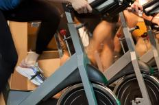 Stationary bikes are used to exercise in indoor cycling classes.