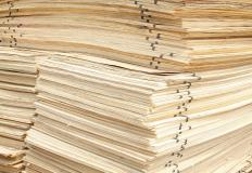 Stacks of plywood sheets, which are used in making countertops.