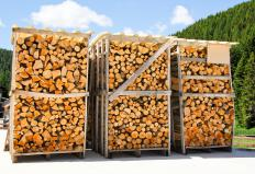 Cut firewood is stored in a wood shed.