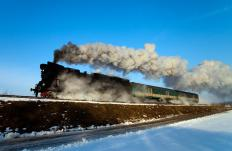 Steam locomotives are examples of piston steam engines, as a piston drives the unit's wheels.