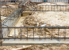 Steel reinforcing bars, or rebar, are inserted into concrete for added support.