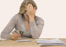 Victims of credit card fraud may experience overdrawn credit and bank accounts.