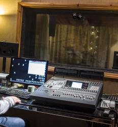 Soundproof glass is used to seal off studio recording booths from unwanted noise.