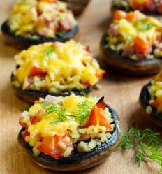 Crab can be part of a stuffed mushroom appetizer.