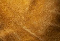 A divan may be upholstered in suede.