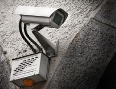 A surveillance camera monitors and records activity within a home or business.