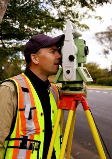 A surveyor uses a theodolite to survey a property.