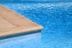 The water in swimming pools is treated with chlorine, which acts as a disinfectant.
