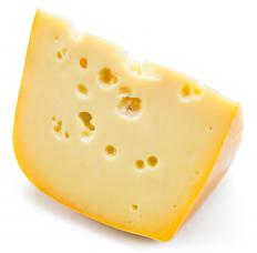 Swiss cheese is a variety of hard cheese made from cow's milk and bacteria that creates the carbon dioxide that makes holes in the cheese.