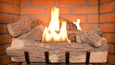 An outdoor fireplace may be used for cooking or for decorative purposes.