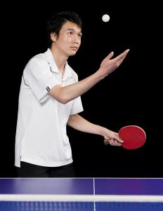 An athlete playing ping pong.