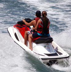 Access to jet skis can be part of a catamaran charter.