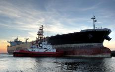 Tugboats are often used to help large vessels, like oil tankers, move within artificial channels.