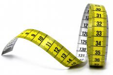 A healthy diet and regular aerobic exercise can help cut inches (cm) from the waist.