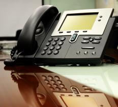 Employees often have digital telephone sets at their individual workstations.