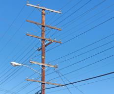 A bucket attached to a Derrick truck is useful for utility workers who must access the top of telephone poles or lights.