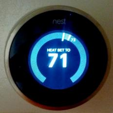 A programmable digital thermostat.