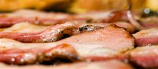 One of the most popular methods of preparing venison backstrap is to wrap the meat in thick-cut bacon before grilling.