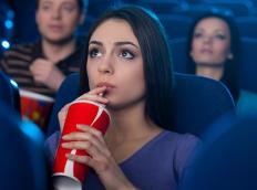 A person may experience sensory adaptation when viewing a film at a theater.