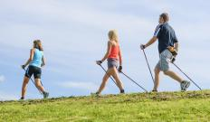 Trekking poles, also known as hiking staffs, here help when hiking up hills or slopes.