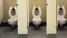 Flushometers are often installed in public toilets to cut down on water usage.